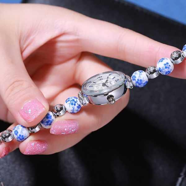 Kimio kék virágmintás gyönggyel díszített női karóra